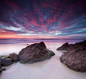 Australian seascape at dawn on square format. Australian seascape at dawn with rocks in foreground (miami beach, queensland, australia Stock Photography