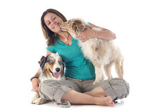 Australian shepherds and woman Royalty Free Stock Photos