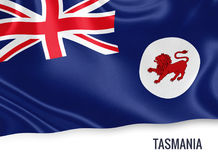 Australian state Tasmania flag. Australian state Tasmania flag waving on an isolated white background. State name is included below the flag. 3D rendering Stock Images