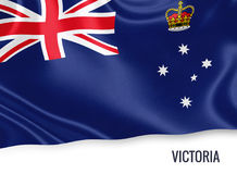 Australian state Victoria flag. Australian state Victoria flag waving on an isolated white background. State name is included below the flag. 3D rendering Stock Image