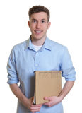 Australian student with file looking at camera Royalty Free Stock Photos