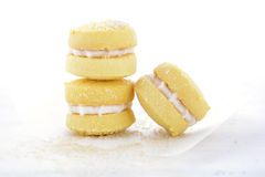Australian style yo-yo biscuits. Stack of traditional Australian style yo-yo biscuit cookies on white paper on shabby chic table Stock Images
