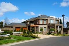 Australian suburb. A modern custom built home in a residential neighborhood Royalty Free Stock Photos