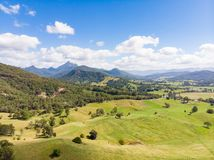 Australian Sugarcane Fields and Landscape. Sugarcane fields near the town of Murwillumbah and Wollumbin National Park Mt Warning in rural New South Wales stock photo
