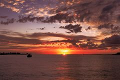Red coloured stratocumulus cloud, supernal sunset seascape. Australia. Australian Summer seascape, waterscape, pink grey and red sunset with primarily royalty free stock photos