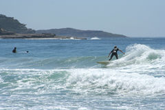 Australian Surfer. Catching a wave at Manly Beach, Sydney, Australia Stock Photography