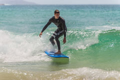 Australian surfer catching a wave Royalty Free Stock Image