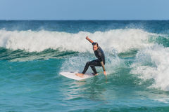 Australian surfer catching a wave Stock Images