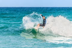 Australian surfer catching a wave Royalty Free Stock Images