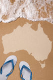 Australian textured map in wet sand on the beach Royalty Free Stock Photo