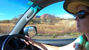 Australian woman driving to Kata Tjuta Olgas in Uluru-Kata Tjuta National Park Northern Territory Australia