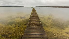 Australian wooden jetty. Mystic cloudy landscape and wooden jetty in Georges Bay, St Helens, the most important city on the East Coast, Tasmania, Australia stock footage