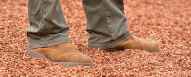 Australian work boot. On ground bark Stock Photography