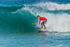 Australian young surfer catching a wave Royalty Free Stock Photography