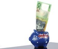 Australiano cento note del dollaro in porcellino salvadanaio Fotografie Stock