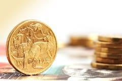 Australiano lle monete dell'un dollaro Immagini Stock
