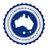 Australien översikt och flagga i den rubber stämpeln för tappning av Arkivfoto