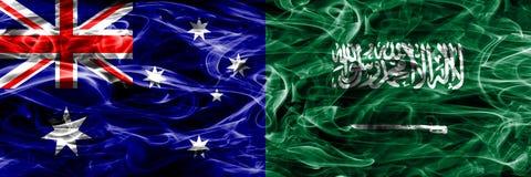 Australien gegen Saudi-Arabien die bunte Rauchflagge gemacht vom dicken Rauche lizenzfreie stockfotos
