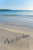 Australien geschrieben auf Fernstrand Stockfotografie