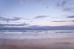 Australiensisk strandsolnedgång Arkivbild