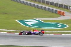 Markera Webber skriver in vänd 1 på malaysisk GP F1 Arkivbild