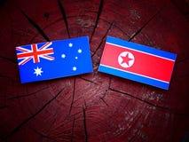 Australijczyk flaga z koreańczyk z korei północnej flaga na drzewnym fiszorku Obrazy Stock