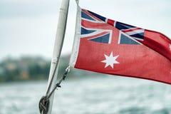 Australijczyk flaga z miasta tłem Zdjęcie Stock