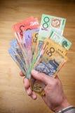 australijczyka gotówki ręka Zdjęcia Stock