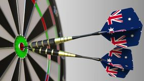 Australische nationale voltooiing Vlaggen van Australië op pijltjes die bullseye raken Het conceptuele 3d teruggeven Stock Afbeeldingen