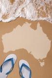 Australische strukturierte Karte im nassen Sand auf dem Strand Lizenzfreies Stockfoto