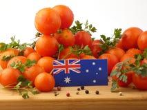 Australische vlag op een houten die paneel met tomaten op een wh wordt geïsoleerd Royalty-vrije Stock Fotografie