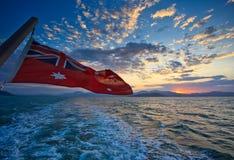 Australischer Markierungsfahnen-Sonnenaufgang im Steinhaufen-Hafen Lizenzfreies Stockfoto
