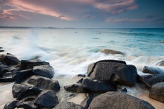 Australischer Strand am Sonnenuntergang Lizenzfreie Stockbilder
