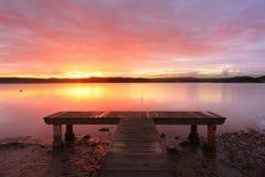 Australisk solnedgång på den gröna punktbryggan Australien Arkivbild
