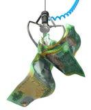 Australiska dollar i en Robotic jordluckrare Arkivfoton