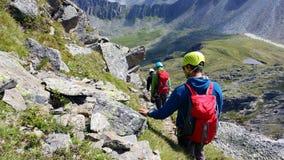 Austria. Alpine region `Stubai`. Climbers on a mountain path. royalty free stock images