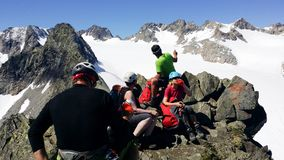 Austria. Alpine region `Stubai`. A group of climbers on top of the `Rinnenspitze` 3000 m. stock photo