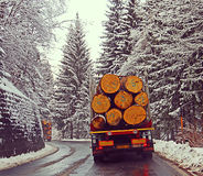 Austria alpine route with snow and heavy loaded trucks Royalty Free Stock Images