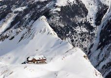 Austria. Alps. Shmittenhorn ski resort. Hotel. Austria. Alps. Shmittenhorn ski resort. Lonely hotel on the brink of the mountain Stock Images