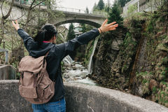 Austria. Bad Gastein. Girl traveler with a backpack. Near the Alpine falls Stock Photography