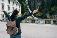Austria. Bad Gastein. Girl traveler with a backpack. Near the Alpine falls Royalty Free Stock Photography