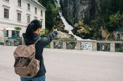 Austria. Bad Gastein. Girl traveler with a backpack. Near the Alpine falls Royalty Free Stock Images