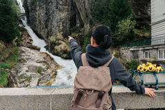 Austria. Bad Gastein. Girl traveler with a backpack. Near the Alpine falls Stock Photo