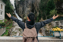 Austria. Bad Gastein. Girl traveler with a backpack. Near the Alpine falls Stock Photos