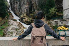 Austria. Bad Gastein. Girl traveler with a backpack. Near the Alpine falls Stock Images