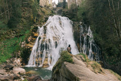 Austria. Bad Gastein. Girl at the waterfall. In the Alpine mountains Royalty Free Stock Image
