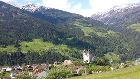 Austria. The beautiful view into the valley in a blue sea. It& x27;s sommer Stock Photo