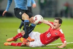Austria contra Bélgica uruguay imagenes de archivo