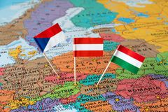 Austria, Czech Republic, Hungary flag pins, Central Europe map Royalty Free Stock Photo