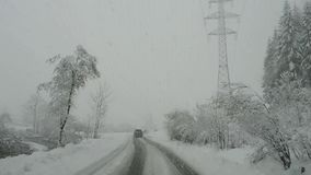 Austria. Driving shot, driver point-of-view. Footage driving on road during a snowfall stock video